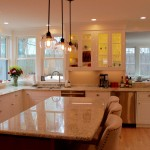 A wide view of a lovely renovated kitchen.